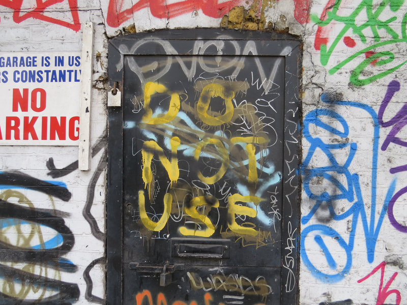 Abandoned doorways covered in graffiti on Derelict London Walking Tour