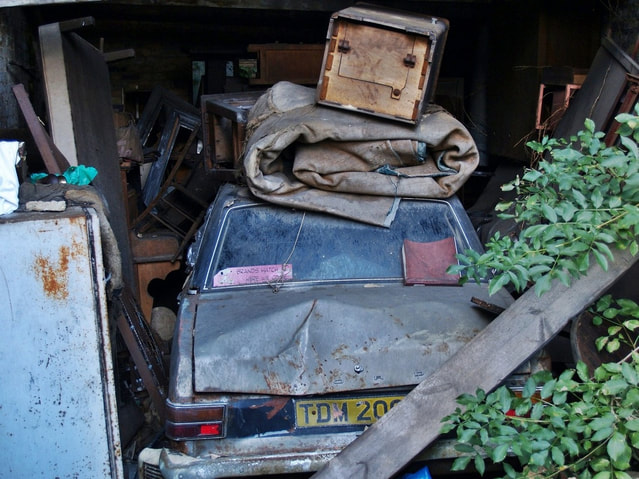 decaying Ford Cortina Mark 2 in abandoned garage in Clapham