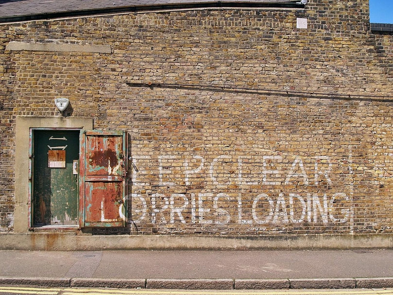 Clapton: Keep Clear Lorries Loading painted on brick wall