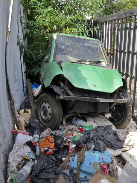 Abandoned wreck of an electric car in East London in no dumping zone