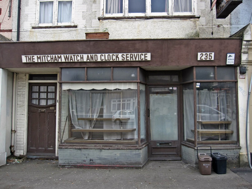 THE DECAYING PREMISES OF THE MITCHAM WATCH AND CLOCK SERVICE - STREATHAM VALE SW16