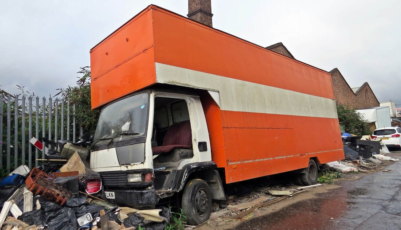 Abandoned orange lorry at the roadside in Bromley-By-Bow E14