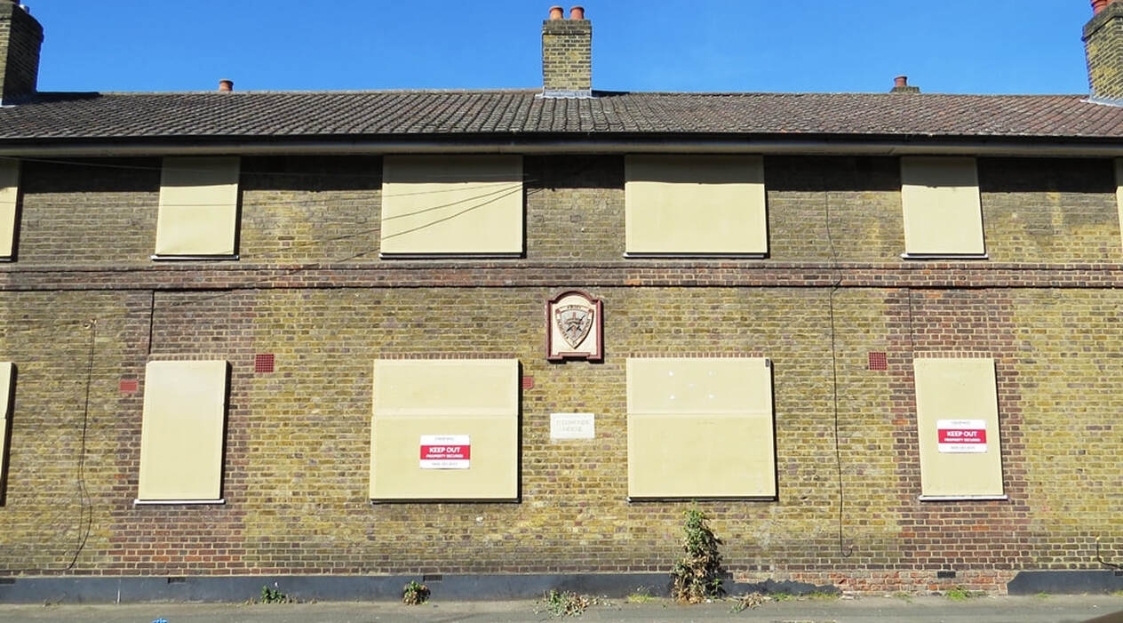Picture of vacant properties - the boarded up Church Army Housing on  Horsley Street and Queen's Row