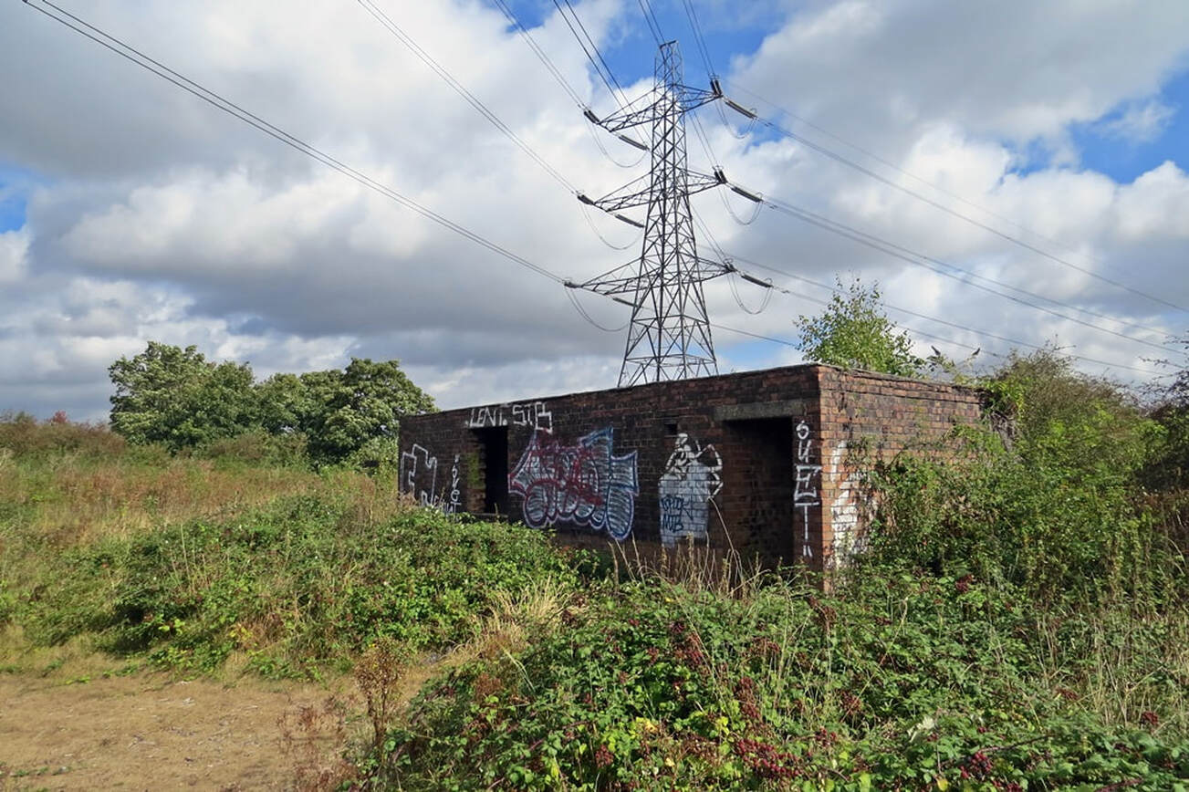Pylons and derelict buildings on site of former Orchard Hospital on Joyce Green Lane in Dartford, DA1