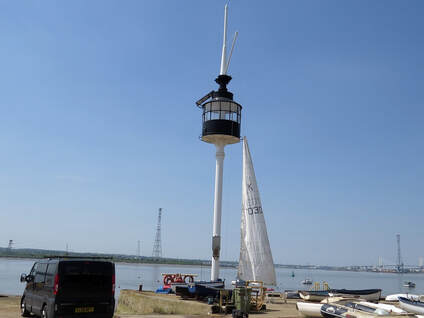 image of The restored light mast of The Gull in the Thurrock Yacht Club on Grays Beach on the River Thames