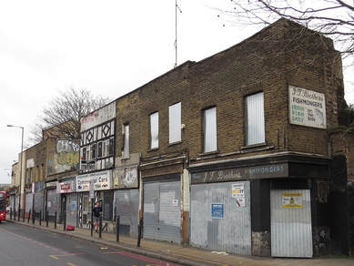 boundary between Stepney and Limehouse  crosses the Commercial Road (A13) to the left of the cab office