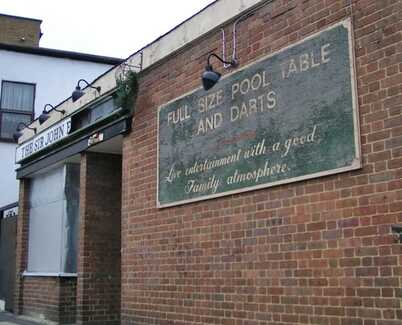 Faded pub sign for a Poplar boozer
