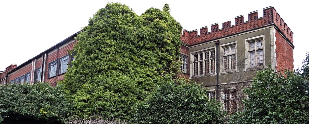 Overgrown derelict and overgrown parts of  Springfield Hospital in Tooting, South London