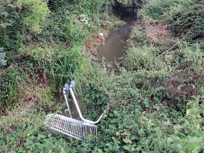 abandoned shopping trolley in the Pymmes Brook in New Barnet, North London