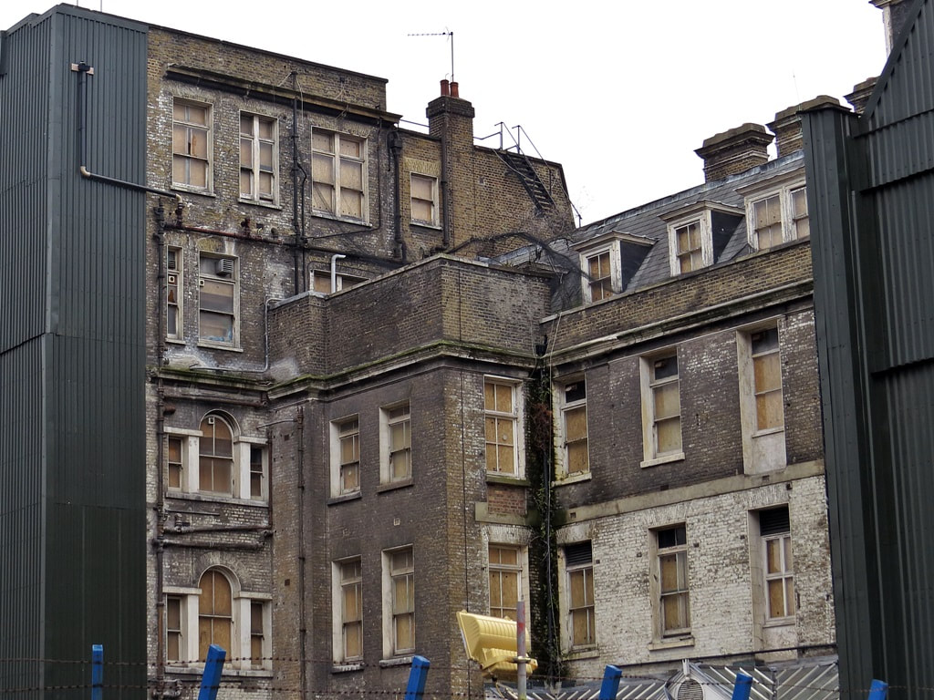 derelict old hospital buildings on Whitechapel High Street opposite Crossrail Elizabeth Line Station