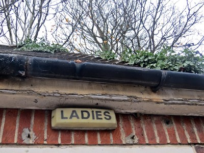 Ladies toilet sign in disused block in SE London