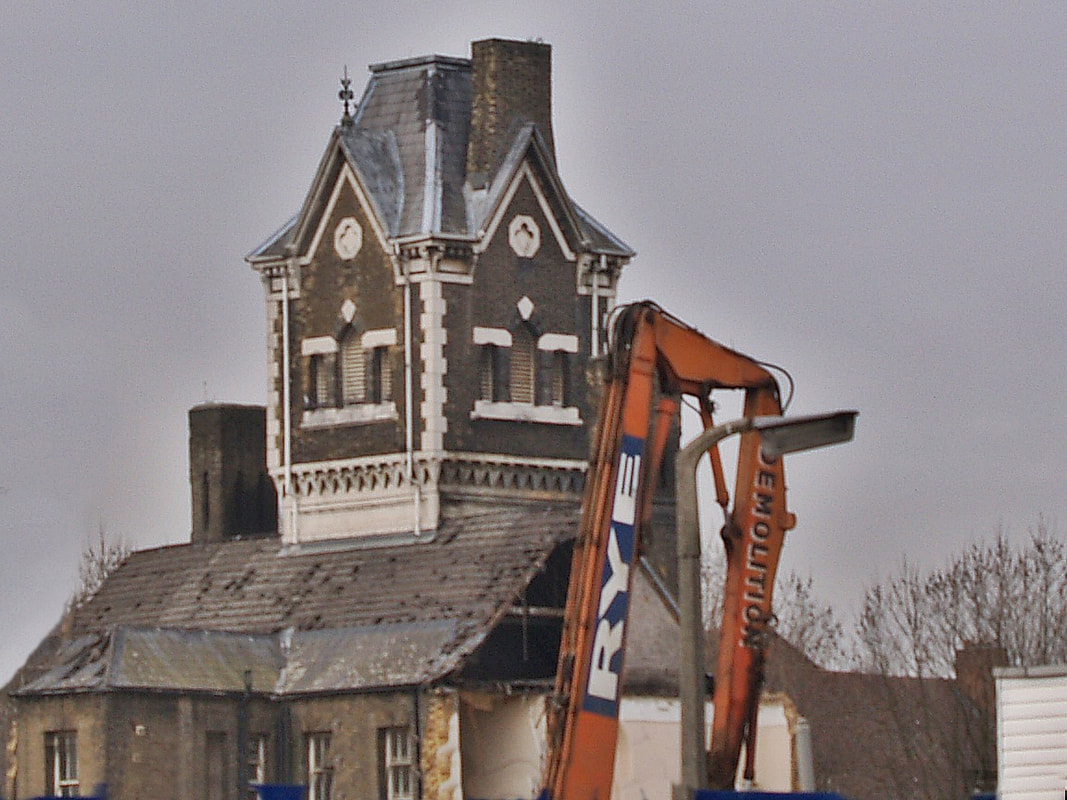Demolition of derelict St Andrews Hospital in Bromley by Bow. Formerly known as the Poplar and Stepney Sick Asylum