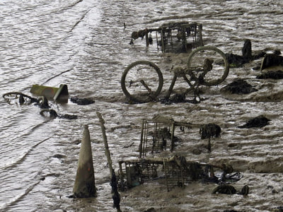abandoned supermarket shopping trolleys, a bicycle and traffic cone in the River Medway