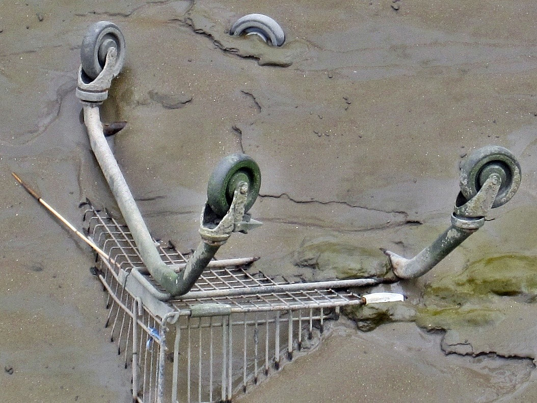 Shopping trolley missing from supermarket car park and in the muddy river in London
