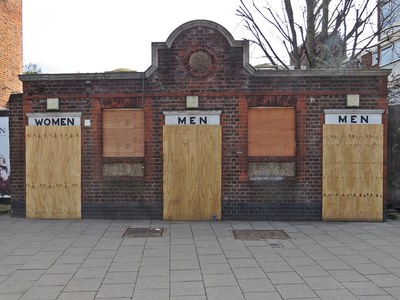 Boarded up closed down public toilets Tottenham High Road N17