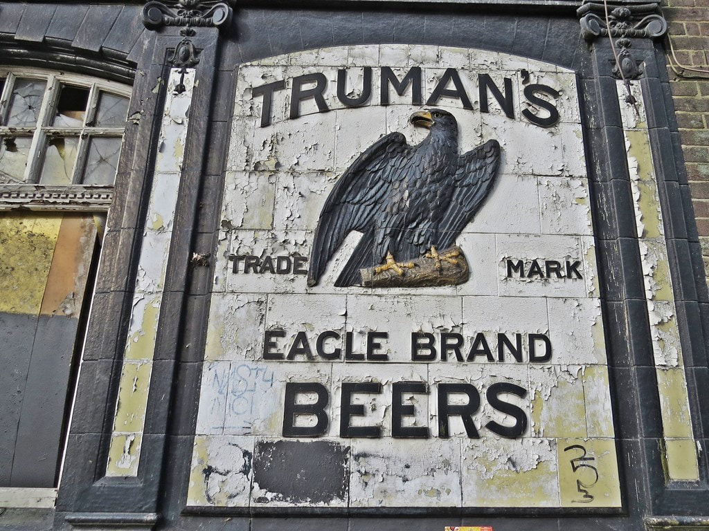 The Truman's Brewery eagle symbol at the derelict Victoria pub on the Woolwich Road