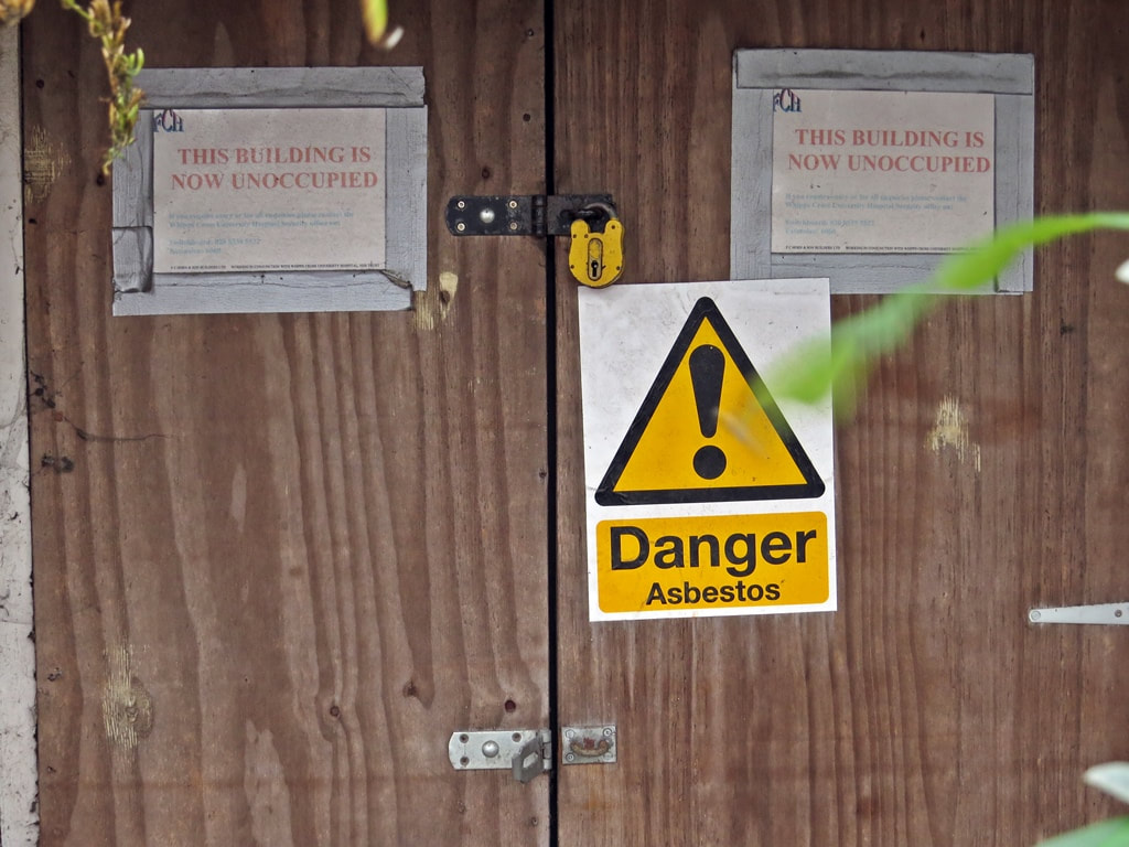 Danger sign at contaminated hospital site in East London