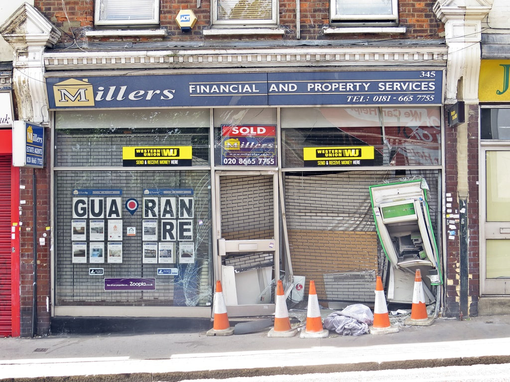 Picture of smashed shop frontage of defunct Millers Financial and Property Services Whitehorse Road Croydon