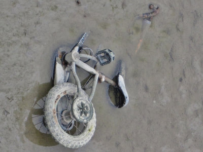 Abandoned child's bike in the River Thames in Woolwich, SE London