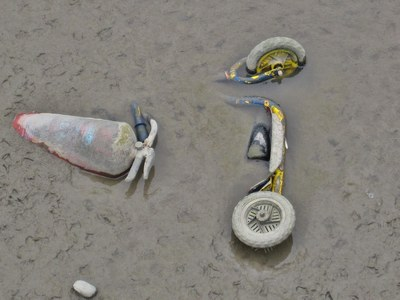 stolen child's toy scooter and fire extinguisher on the Thames foreshore in SE London